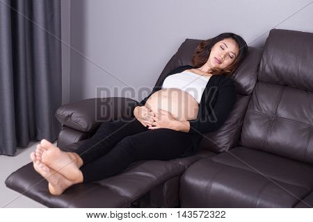 Pregnant Woman Sleeping On Sofa