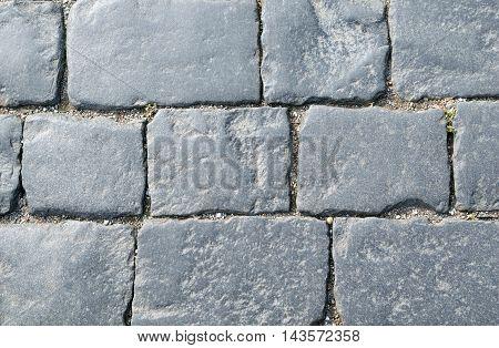 Background of rectangular paving cobblestones of square