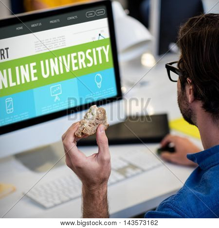 Online university interface against high angle view of man working on computer