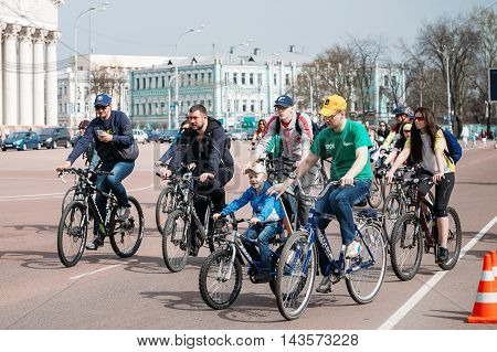 Gomel, Belarus - April 10, 2015: Group of young people cyclists ride on street at opening of the cycling season in the city