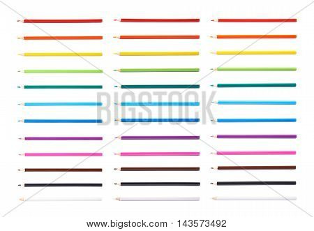 Set of multiple color pencils isolated over the white background, each color presented in three foreshortening versions