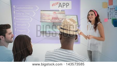 Digitally generated mobile application concepts against businesswoman giving presenting in front of group