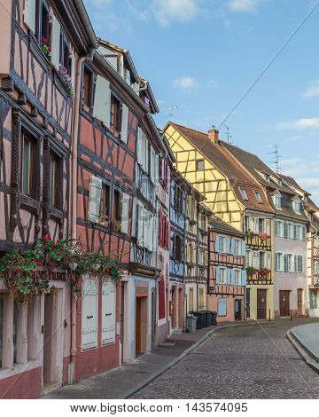 COLMAR FRANCE - 30TH JULY 2016: A view of colourful timber framed buildings along Little Venice in Colmar during the morning