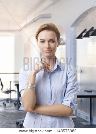 Portrait of attractive caucasian businesswoman at office