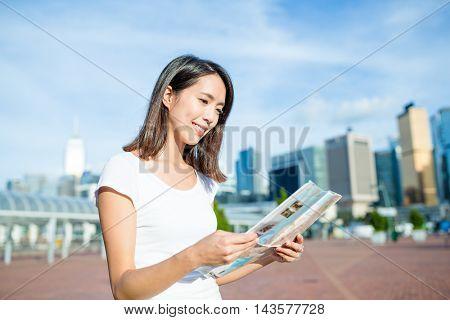 Woman visiting Hong Kong with paper map