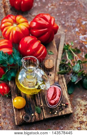 Olive oil, tomato sauce and fresh tomatoes. Italian cuisine. Ingredients for cooking.