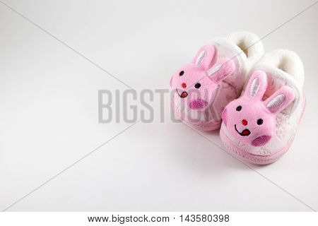 Baby booties on a white background .