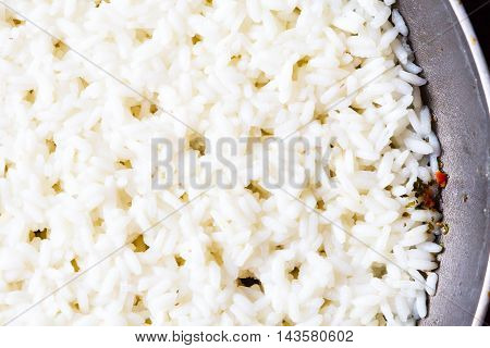 close up macro cooked rice in frying pan texture background
