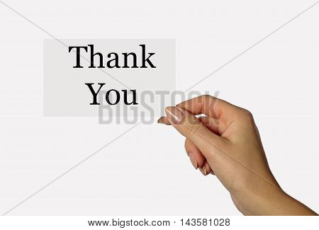 Beautiful hand of a young girl holding a card on a white background with the words Thank You