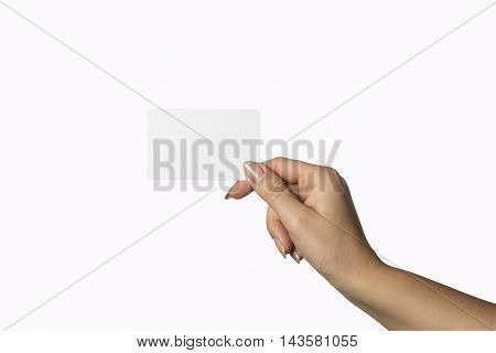 a blank sheet of white paper in hand between fingers. Hand to the left. Isolated over white background.