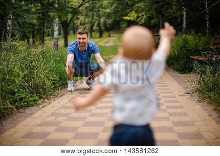 Child boy Running Towards Father in park