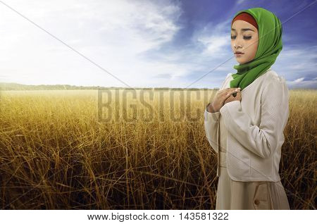 Young Asian Muslim Woman With Hijab Style