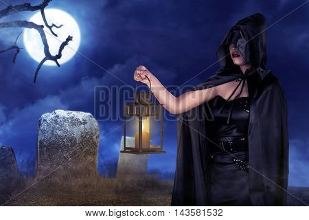 Halloween Witch Woman Holding Lantern With Fog With Moonlight