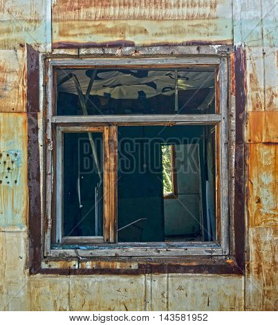 An old window in an old abandoned house. An old window. Windows.