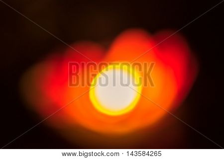 Floating paper lantern on the water at night. Image not in focus