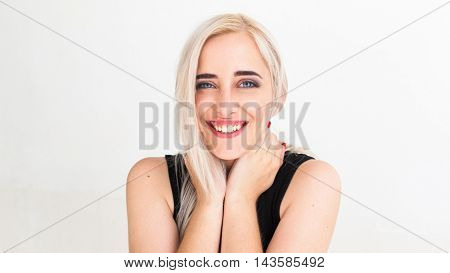 Widely smiling at camera pretty blonde. Lovely woman with strange smile hugging her neck and laughing, Happiness, fun, frivolity