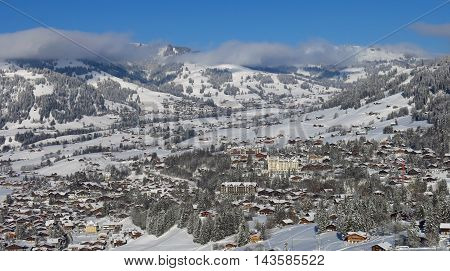 Gstaad in winter. Village and holiday resort in the Swiss Alps.