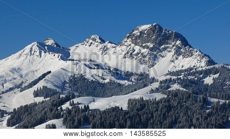 Mountain and ski area in Gstaad Swiss Alps. Mt Videmanette on a beautiful winter day.