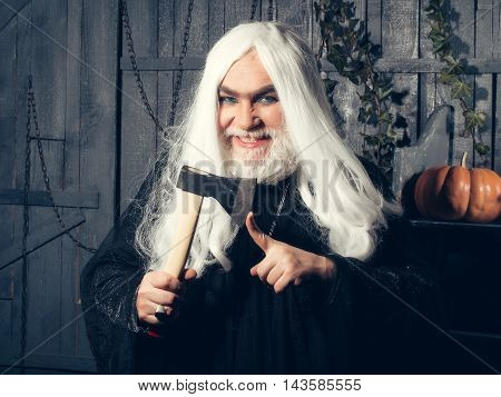 Grey-haired Sorcerer With Axe