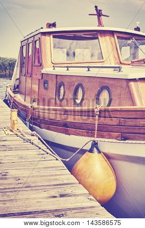 Wooden Boat Moored To A Pier In Marina.
