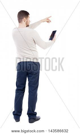Back view of  pointing young men talking on cell phone. Young guy  gesture. Rear view people collection.  backside view of person.  Isolated over white background.The bearded man in a white warm