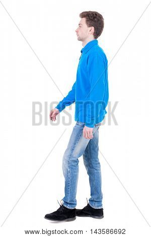 Back view of going  handsome man. walking young guy . Rear view people collection.  backside view of person.  Isolated over white background. Curly boy in the blue jacket is thoughtfully to one side.