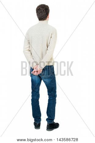 Back view of man . Standing young guy. Rear view people collection.  backside view of person.  Isolated over white background.Curly short-haired man in a woolen white jacket standing with his hands