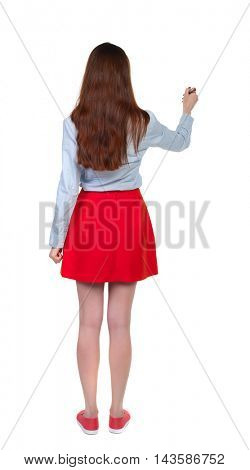 back view of writing beautiful woman. Young girl in dress. Rear view people collection.  backside view of person. Isolated over white background. Long-haired brunette in red skirt draws a felt-tip pen