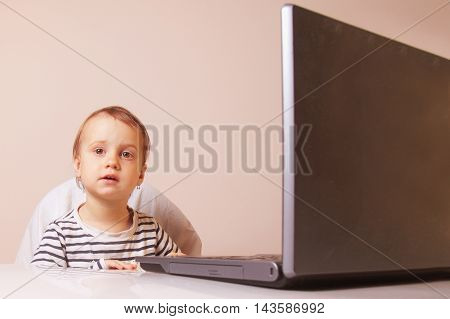 business baby girl works with the laptop (humorous picture)