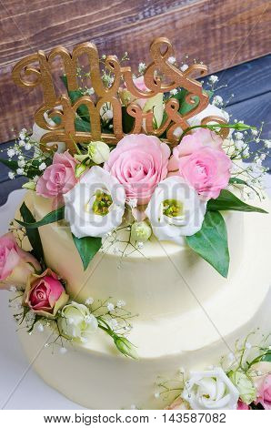 Two  Layered Wedding Cream Cheese Cake With Roses And Eustoma