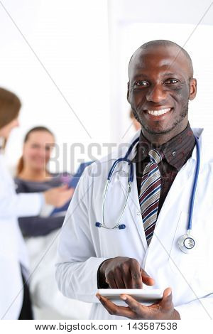 Black Male Doctor Point With Finger In Digital Tablet Pc