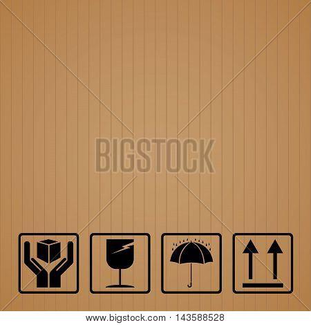 Black fragile symbol on brown cardboard. Fragile symbol.