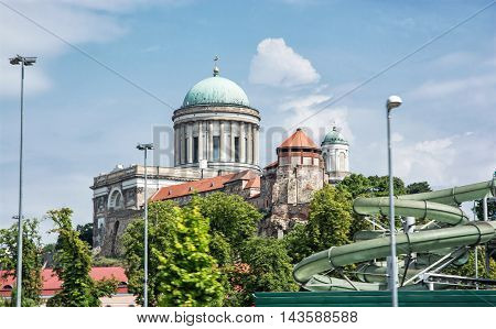 Beautiful basilica and water slide in the thermal spa and baths in Esztergom Hungary. Cultural heritage. Travel and recreation. Leisure activity.