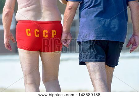 The man on the beach in a bathing suit with the inscription USSR