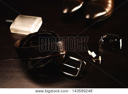 Men's accessories. Shoes with belt and perfume