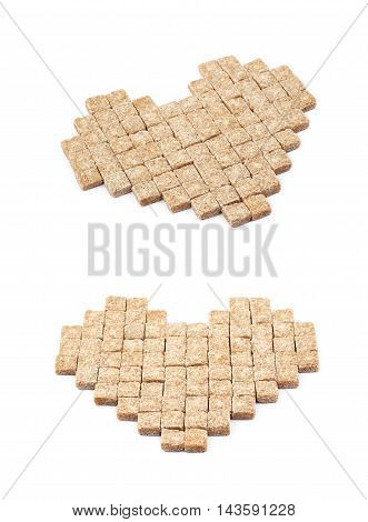 Heart shape made of multiple brown sugar cubes isolated over the white background, set of two different foreshortenings