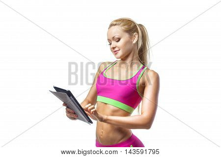 Sport, excercise, technology, internet and healthcare consept- sporty woman with tablet pc