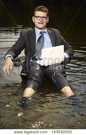 Businessman in suit and tie relaxing after burning out