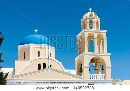Yellow church with blue dome in Santorini - Greece