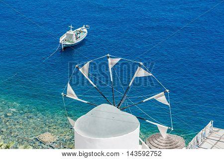 Windmill over the sea in Santorini - Greece