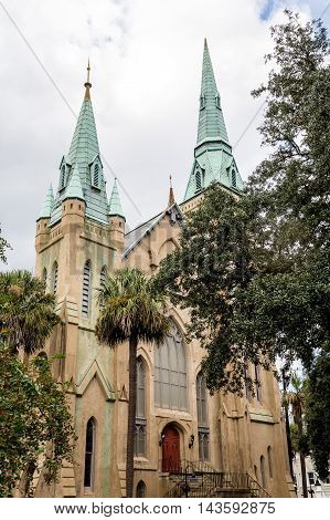 Church with Green Steeples and Red Doors in Savannah