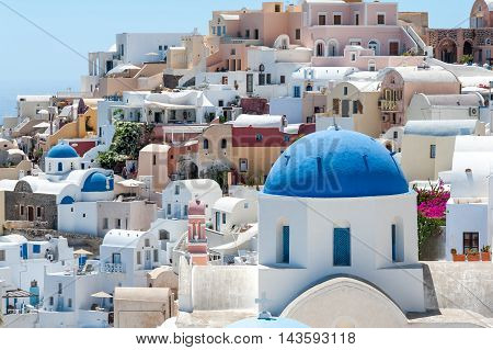 White and blue view of Santorini with domes - Greece