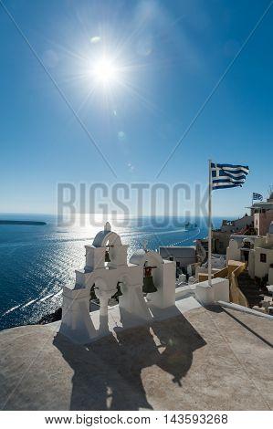 Top of orthodox church with greece flag - Santorini - Greece