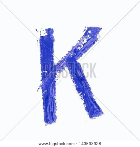 Single k latin letter symbol drawn with a wax crayon isolated over the white background
