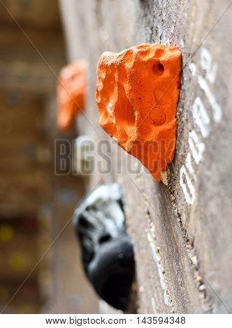 Climbing wall, low angle shot with selective focus. Rock climbing.