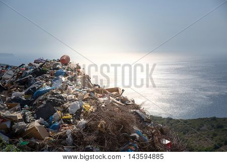 Heap of trash beside the sea. Concept photo of pollution problem of the sea and nature which effects sea life like turtles. Plastic needs up to 450 years to decompose.