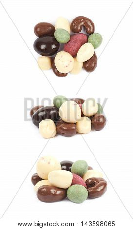 Pile of multiple differently glazed chocolate nuts isolated over the white background, set of three different foreshortenings