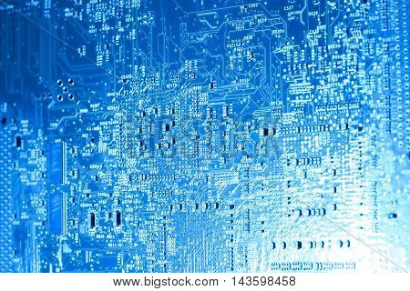 full frame blue illuminated printed circuit board closeup