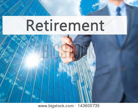 Retirement - Businessman Hand Holding Sign