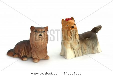 Two Dog Figurines On White Background